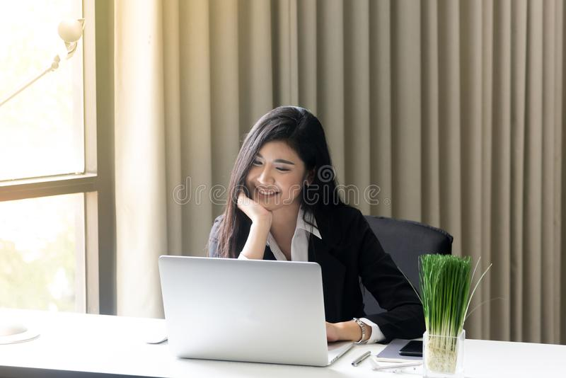 Beautiful business woman working on her laptop while sitting at office. Closeup beautiful business woman working on her laptop while sitting at office royalty free stock photos