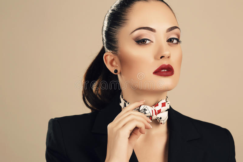 Beautiful businesslike woman in elegant black jacket. Fashion studio portrait of beautiful businesslike woman in elegant black jacket royalty free stock images