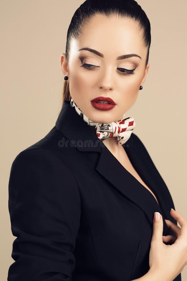 Beautiful businesslike woman in elegant black jacket. Fashion studio portrait of beautiful businesslike woman in elegant black jacket royalty free stock image