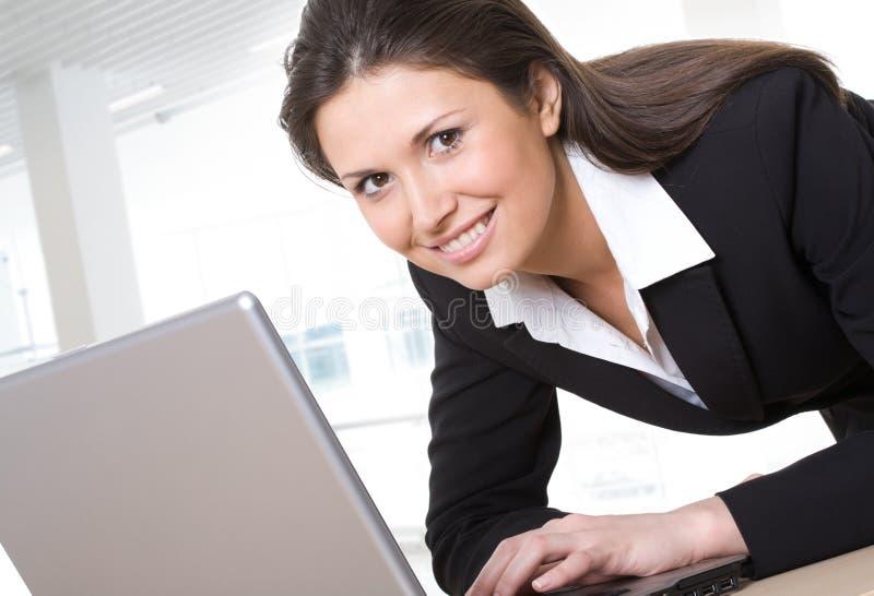 A beautiful businesswoman. Portrait of beautiful businesswoman using lap-top stock photo