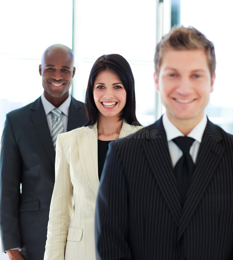 Beautiful businesswoman in focus with her team royalty free stock photos
