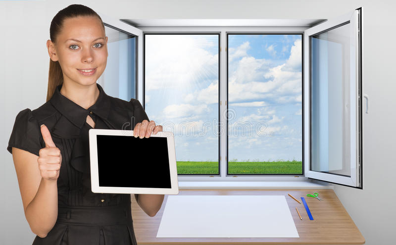 Beautiful businesswoman holding blank tablet PC stock photography