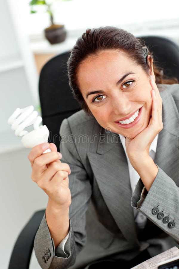 Download Beautiful Businesswoman Holding A Light Bulb Stock Image - Image: 16093597