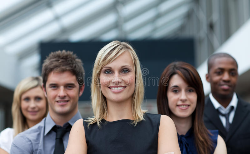 Beautiful businesswoman leading her team royalty free stock images