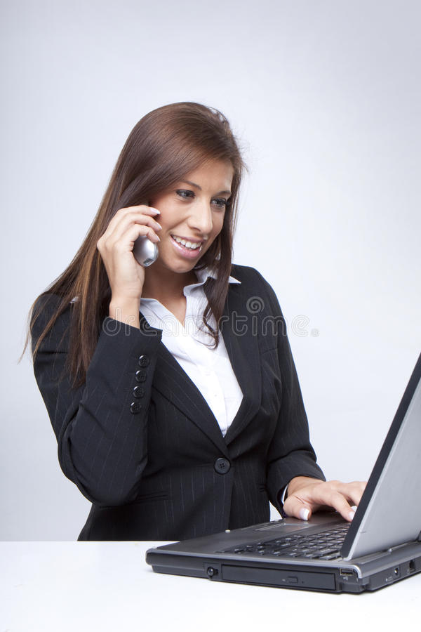 Beautiful Businesswoman on Phone royalty free stock image