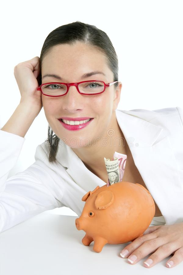 Beautiful businesswoman with piggybank over white royalty free stock image