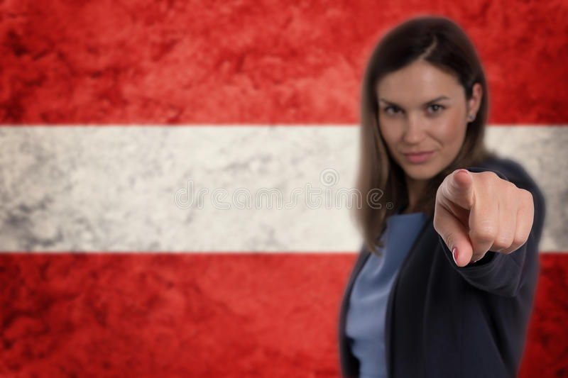 Beautiful businesswoman pointing her finger at you Austrian flag royalty free stock photo
