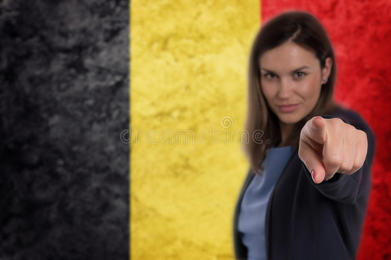 Beautiful businesswoman pointing her finger at you Belgian flag stock photos
