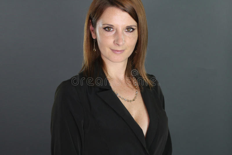 Beautiful businesswoman posing. Over a gray background stock photos
