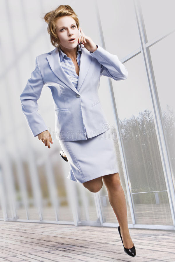 Beautiful businesswoman running royalty free stock photo