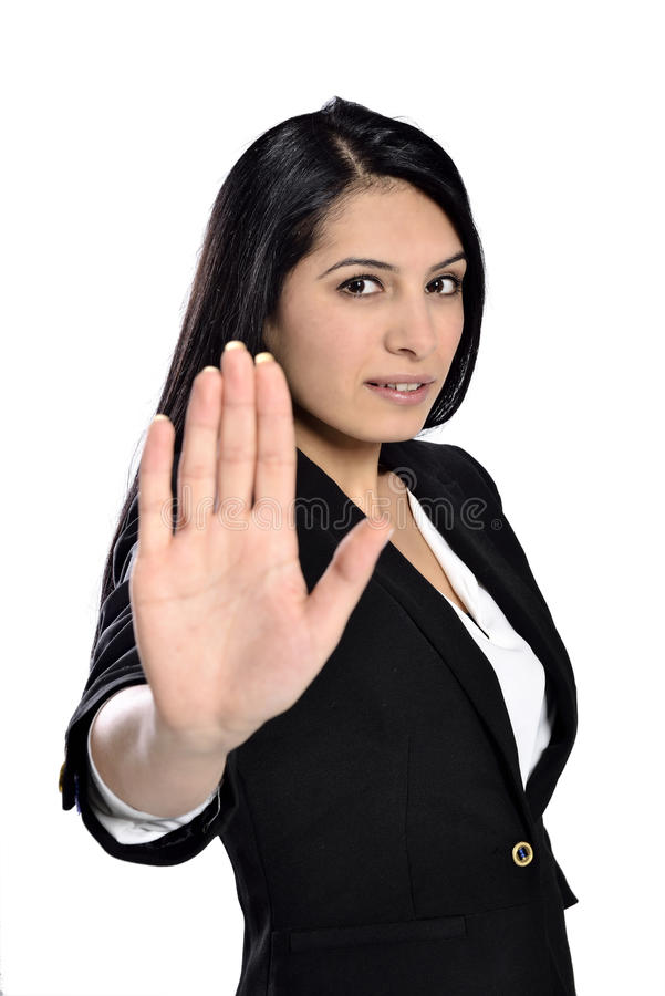 Beautiful businesswoman say no. Business woman with hand extended to say no stock images
