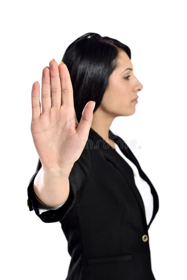 Beautiful businesswoman say no. Business woman with hand extended to say no royalty free stock image