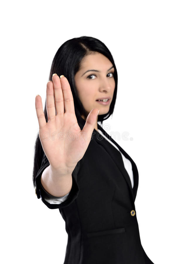 Beautiful businesswoman say no. Business woman with hand extended to say no royalty free stock photography