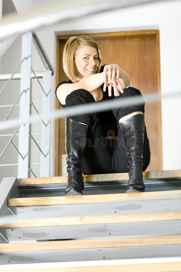 Beautiful businesswoman sitting on stairs royalty free stock images