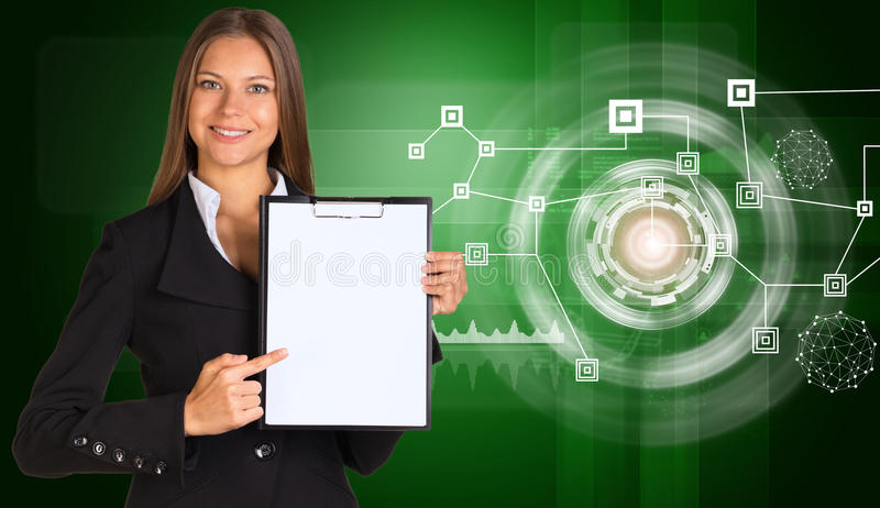 Beautiful businesswoman in suit holding paper. Holder. Network with circles. Technology concept royalty free stock photo