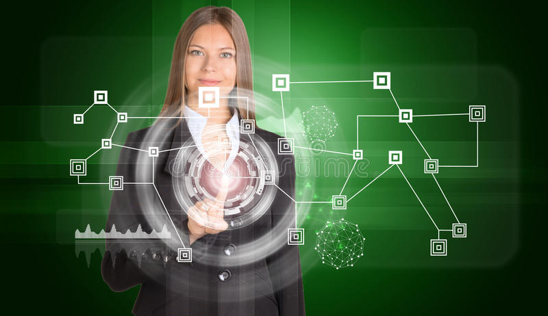 Beautiful businesswoman in suit presses finger on. Virtual icon. Network with circles. Technology concept royalty free stock image