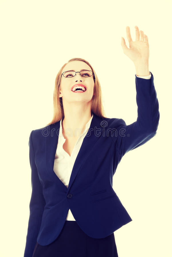 Beautiful businesswoman touching an abstract space stock photography