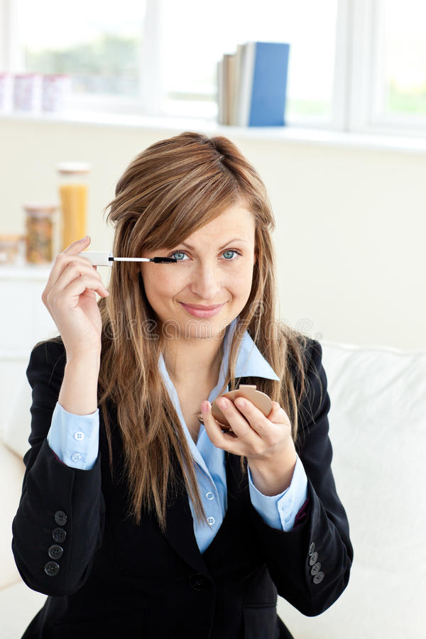 Download Beautiful Businesswoman Using Mascara On A Sofa Stock Photo - Image: 15518628
