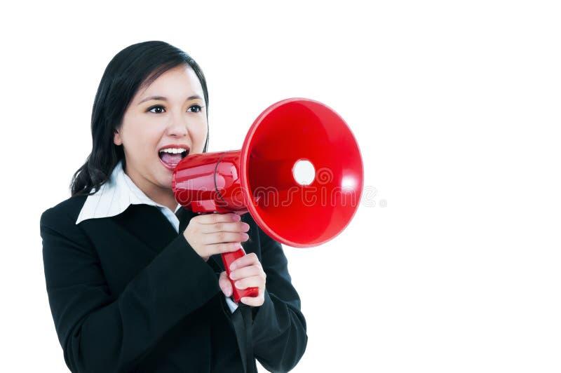 Beautiful businesswoman using megaphone royalty free stock image