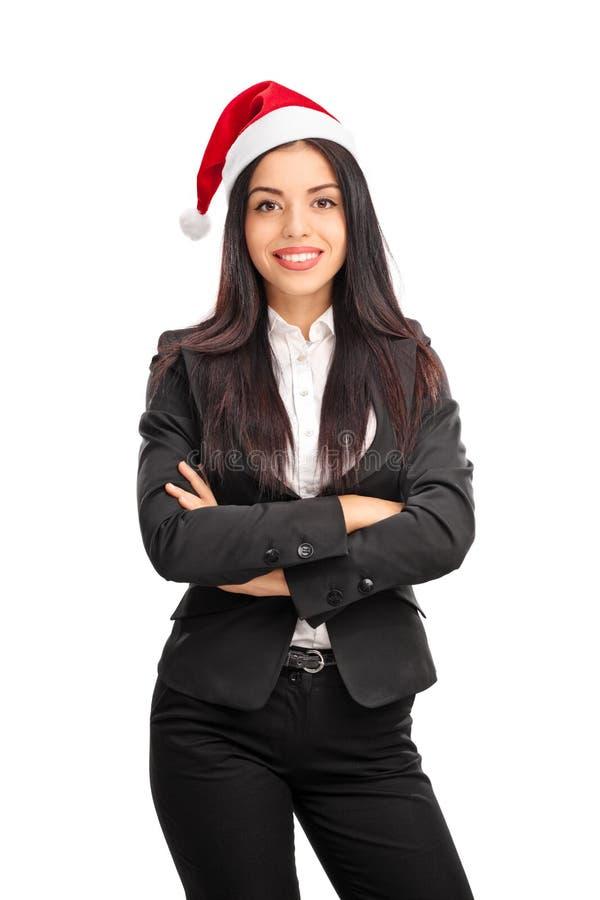 Beautiful businesswoman wearing Santa hat royalty free stock photos