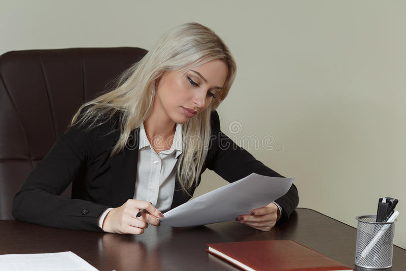 Beautiful businesswoman working with documents royalty free stock photography