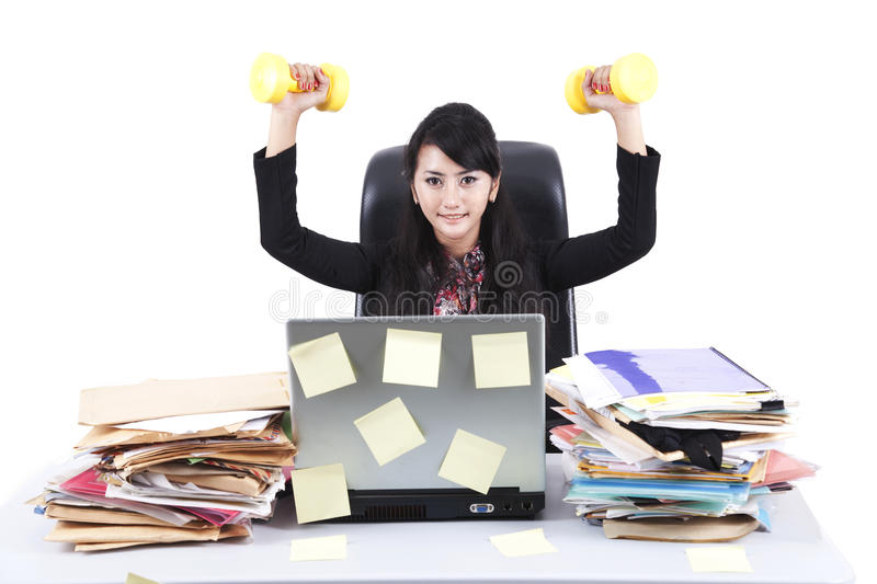 Download Beautiful Businesswoman Working Out In The Office Royalty Free Stock Photography - Image: 22809807