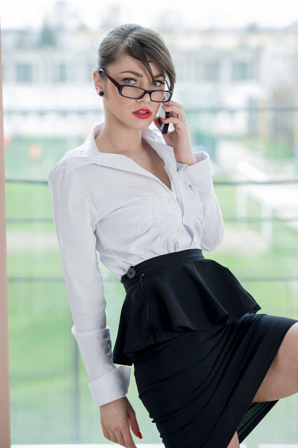 Beautiful bussines woman. Beautiful Girl talking by mobilphone stock image