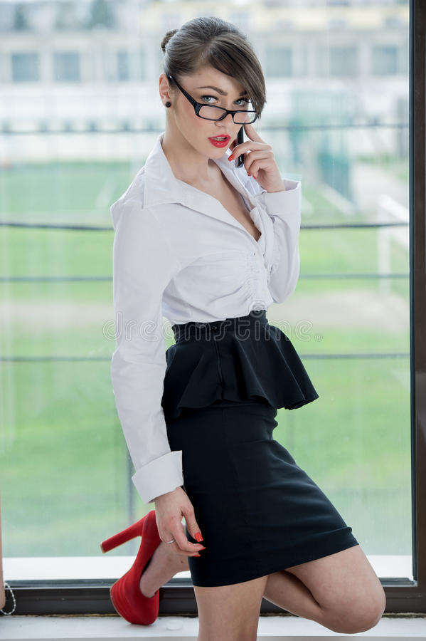 Beautiful bussines woman. Beautiful Girl talking by mobilphone royalty free stock images