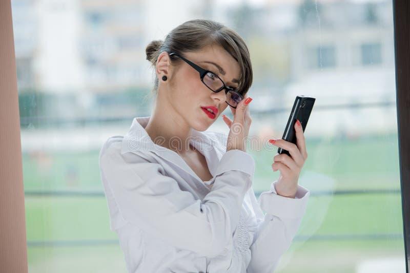 Beautiful bussines woman. Beautiful Girl talking by mobilphone stock photos