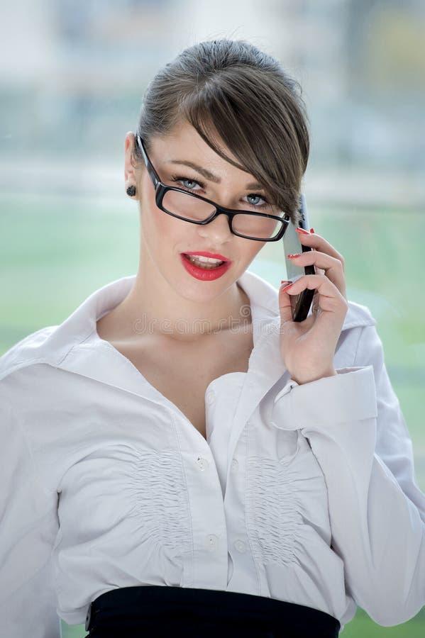 Beautiful bussines woman. Beautiful Girl talking by mobilphone royalty free stock image
