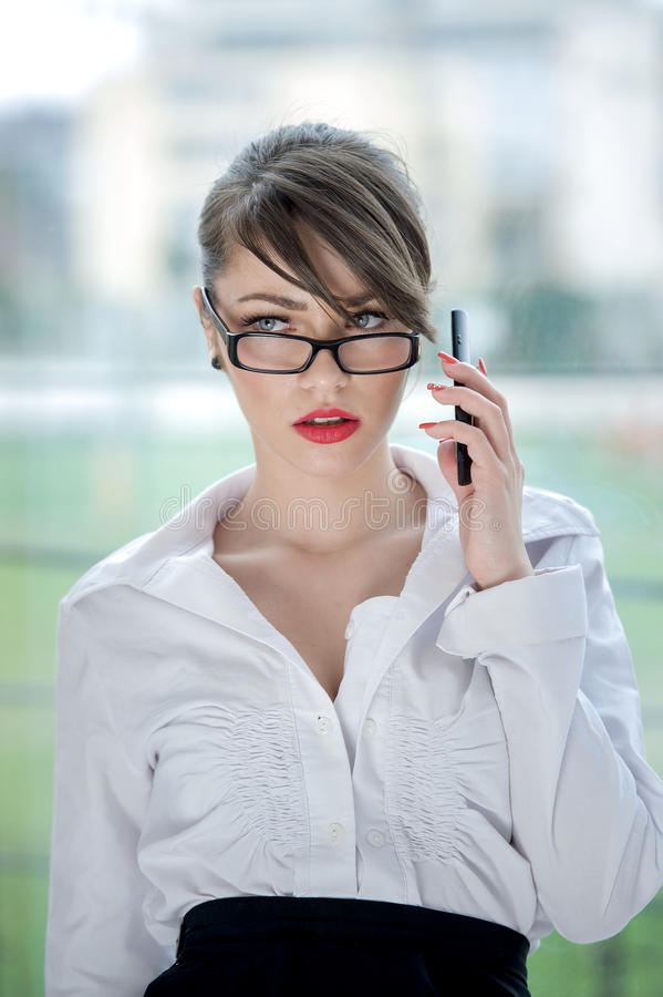 Beautiful bussines woman. Beautiful Girl talking by mobilphone stock photo