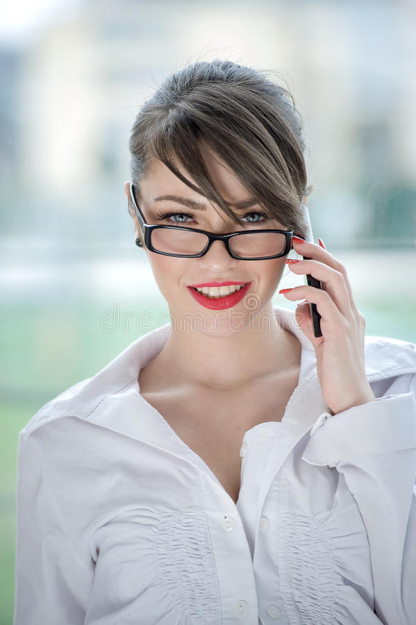 Beautiful bussines woman. Beautiful Girl talking by mobilphone royalty free stock photography