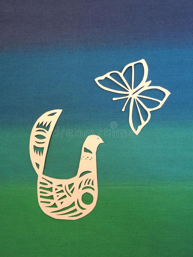 Beautiful white butterfly and bird cut from paper stock illustration
