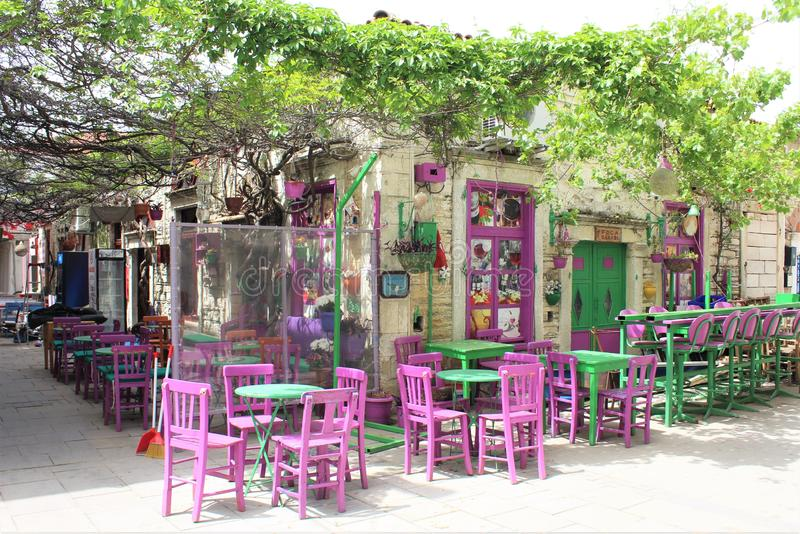 Beautiful cafe with purple and green colors. It is taken from a famous place called Foça, there are old houses and a beautiful sea stock image