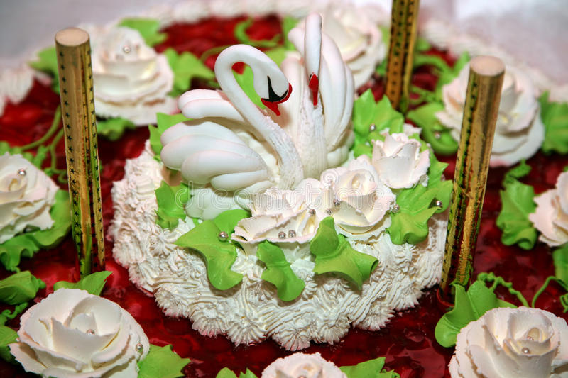 Beautiful cake for wedding with figures of swans closeup royalty free stock photography