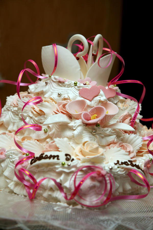 Beautiful cake for wedding with figures of swans closeup stock image