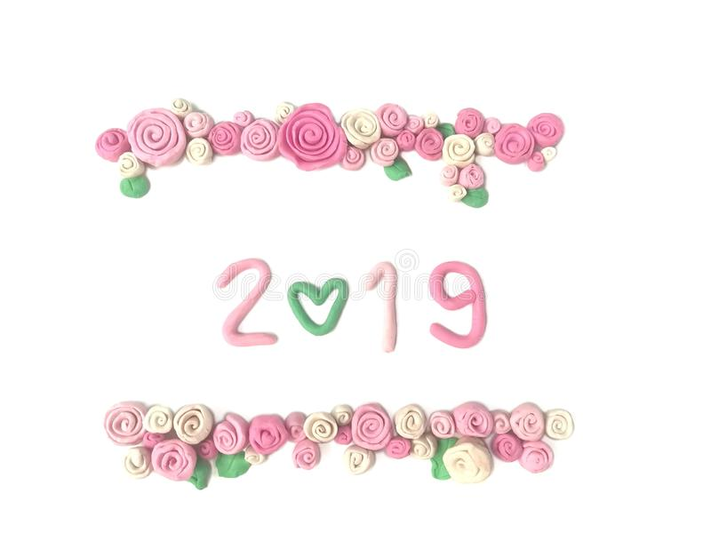 Beautiful year 2019 plasticine clay, number 0 heart shape, sweet rose flower dough stock photography