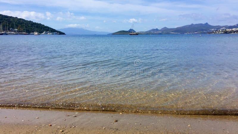 Beautiful calm blue bay royalty free stock photos