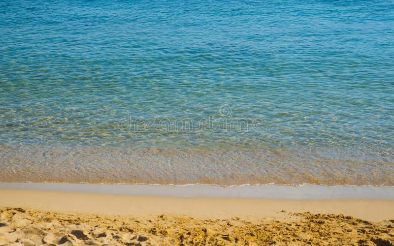 Beautiful calm sea on a empty relaxing sandy beach royalty free stock photography