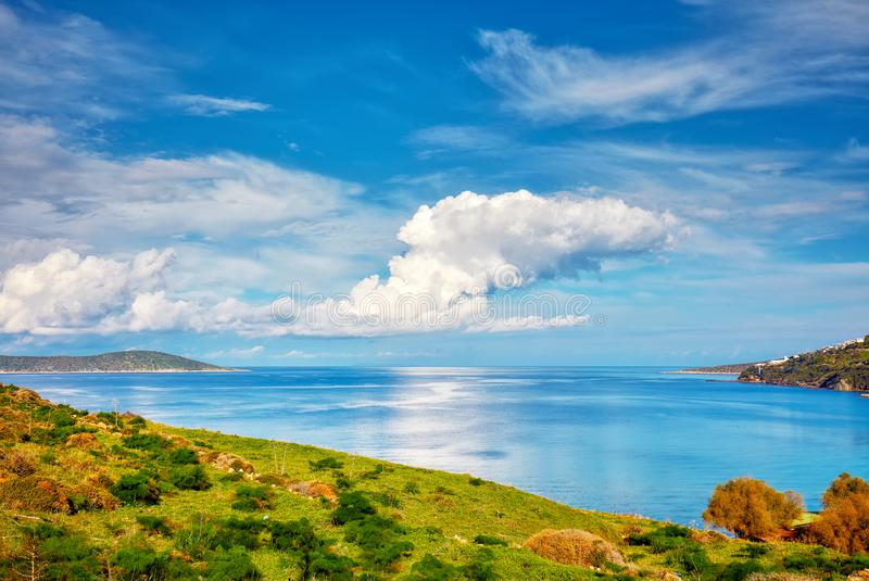 Beautiful calm sea, meadow field, clouds, sky and island landscape of a holiday place. In Cukurbuk bay, Bodrum, Mugla, Turkey stock photography