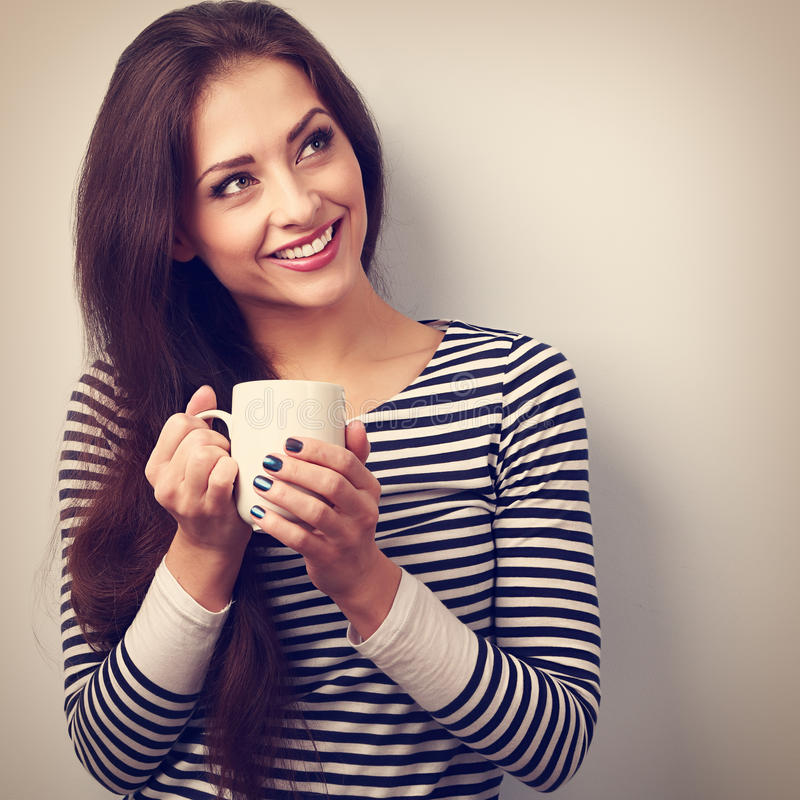 Beautiful calm thinking woman drinking hot coffee from cup. Vintage closeup portrait stock photography