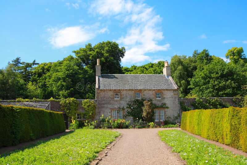 Beautiful Calzean Castle garden with old cottage stock image