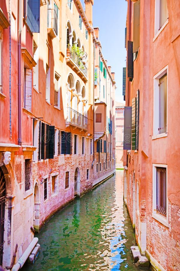 Beautiful canal in Venice, Italy. Old colorful buildings and bright green water. Beautiful  canal in Venice, Italy. Old colorful pink and orange buildings and stock images