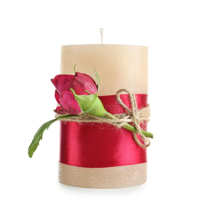 Beautiful candle with flower on white background stock image