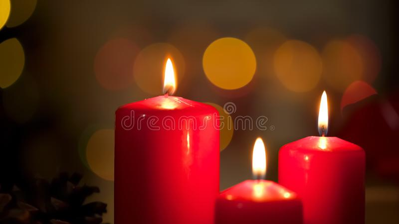 Beautiful candles burning creating calm and relaxing atmosphere, spa salon. Stock photo royalty free stock images