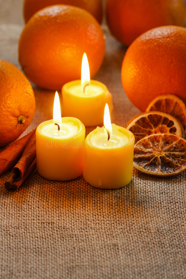 Beautiful Candles And Juicy Oranges Stock Photo