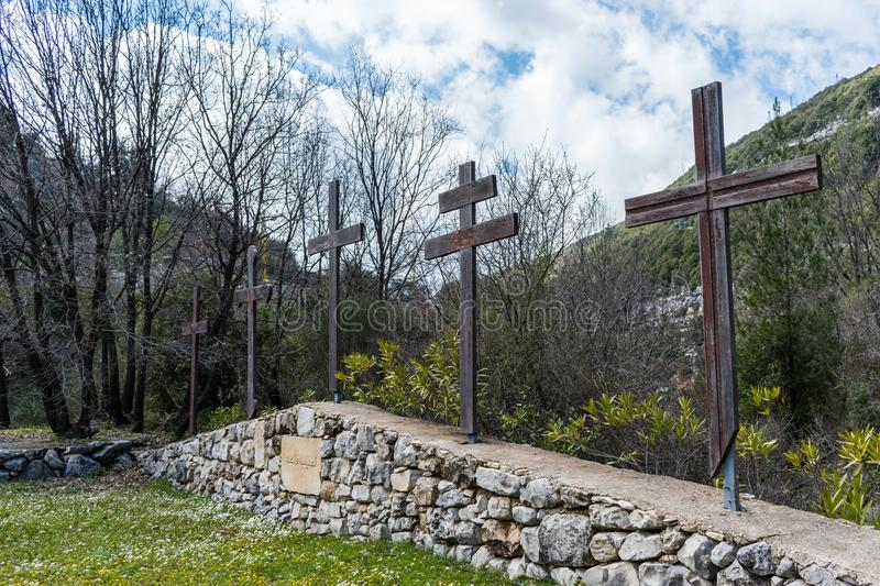 Beautiful capture of a multi cross design. This is a capture for a multiple christian crosses which sit on a wall of stones with a green forest background royalty free stock photo