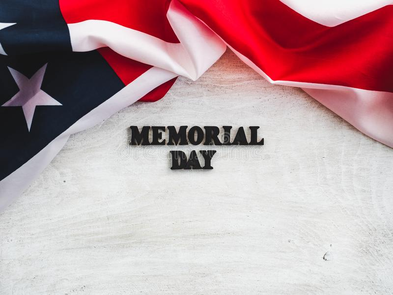 Beautiful card for the Memorial Day. Close-up. Beautiful card for the Memorial Day. Wooden letters with a congratulatory inscription on a white background. Close royalty free stock images