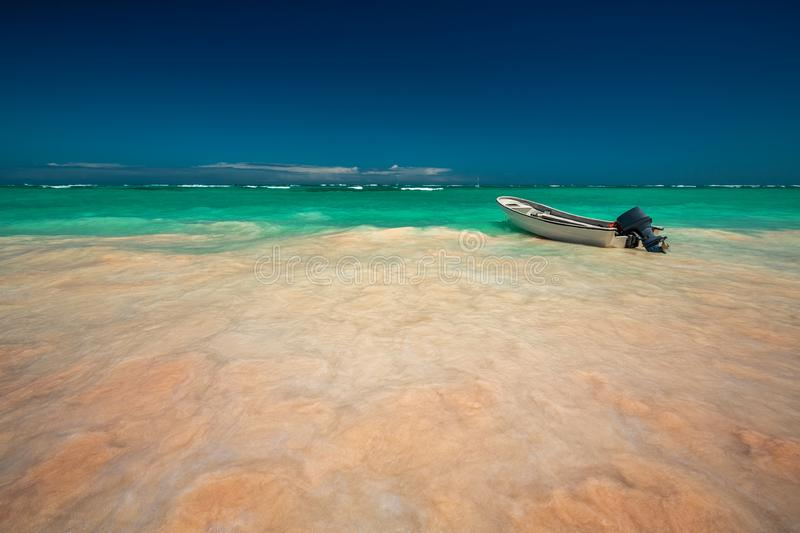 Caribbean sea and boat on the shore, beautiful panoramic view royalty free stock images