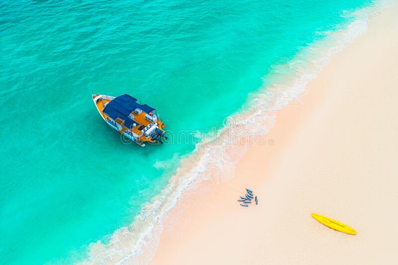Beautiful carribean sea and boat , aerial view from the beach stock images